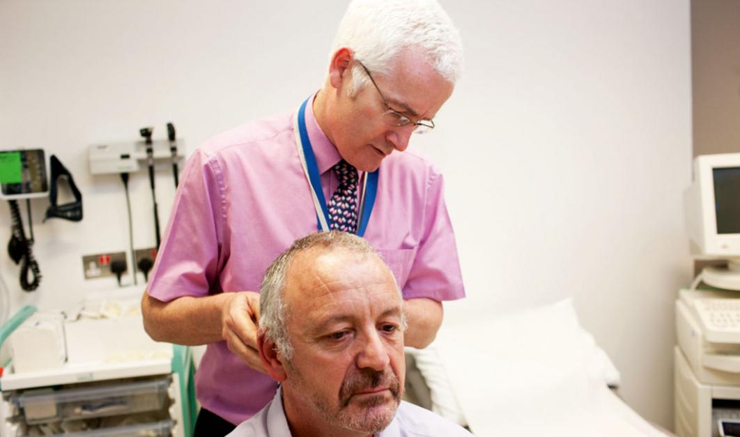 Professor Kevin Harrington with a patient