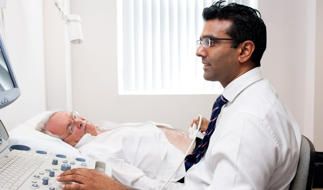 Mr Pardeep Kumar, Consultant Urological Surgeon, with a patient