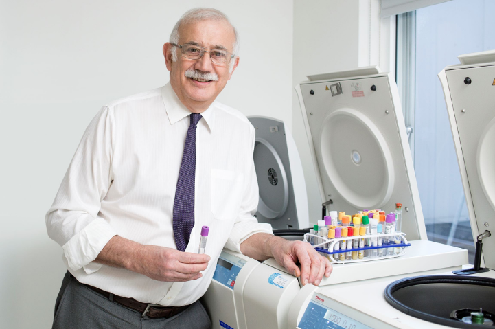 Stan Kaye standing with lab equipment
