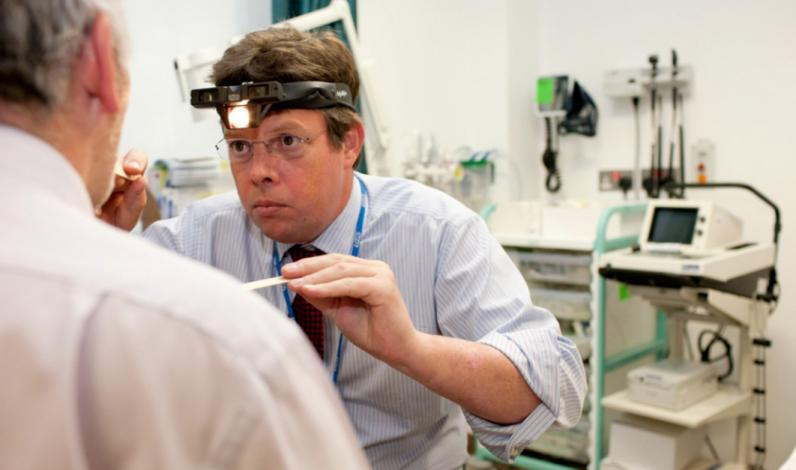 Professor Chris Nutting examines patient at the Head and Neck Unit