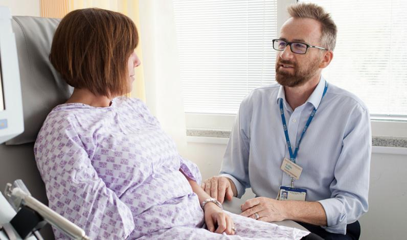 Dr Mike Potter, Head of Haemato-oncology Unit, with a patient