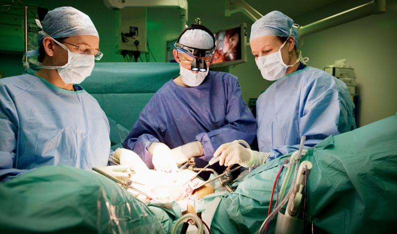 Surgeons Mr John Butler, Mr Des Barton and Ms Marielle Nobbenhuis using the PlasmaJet on a patient with ovarian cancer