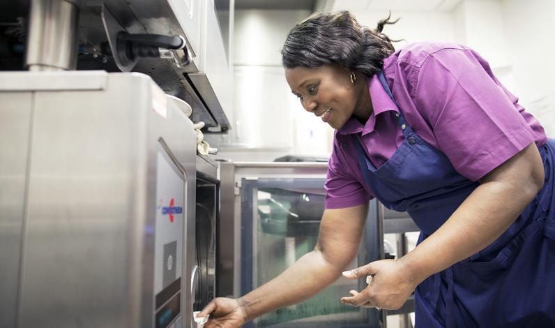 Ward Hostess Gifty Brobbey preparing food