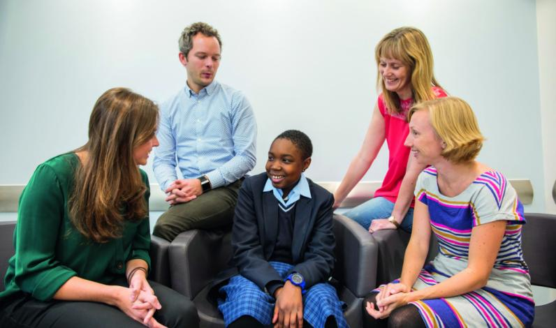 Young patient Theodora-Angelica Acha with scientists Ruby Callister, Oliver Gurney-Champion, Carol Box and Corrinne Brooks