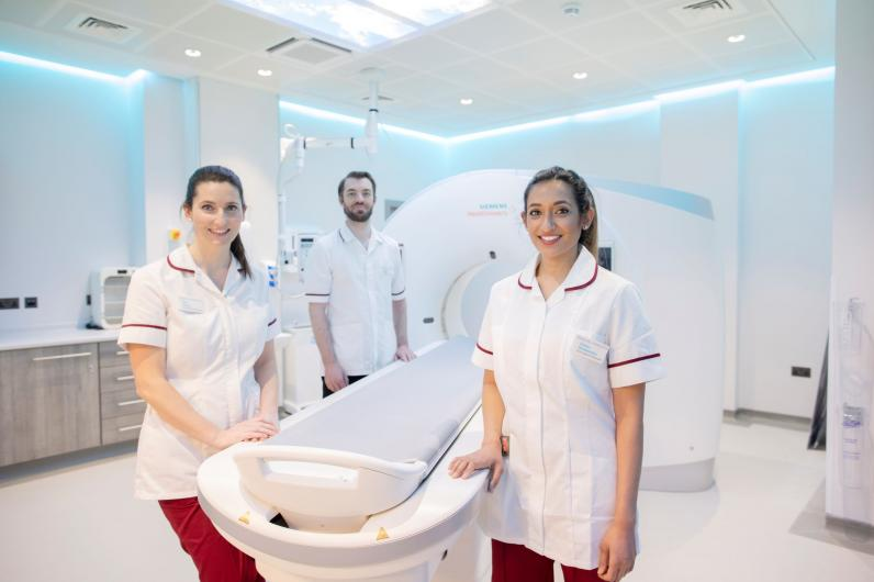 Staff with CT scanner at Cavendish Square