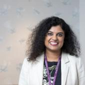 Susana Banerjee, Consultant Medical Oncologist, wearing white jacket in Granard House Private Care reception area
