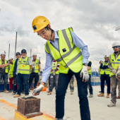 Chief Operating Officer at The Royal Marsden, Karl Munslow Ong, lays the final block of concrete